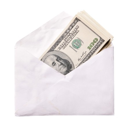 Dollars in envelope isolated over a white background photo