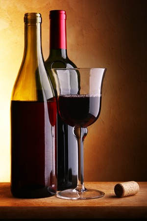 Still-life with two wine bottles and glass