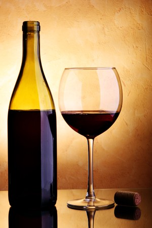 Still-life with wine bottle and glass photo