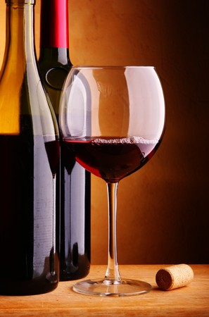 Still-life with two wine bottles and glass photo