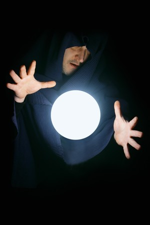 Wizard with glowing magical sphere close-up photo