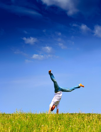 Freedom - Young girl have fun on the flank of hill Stock Photo - 4285150