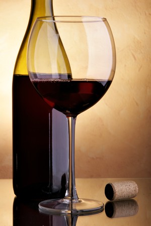 Still-life with wine bottle of red wine and glass photo