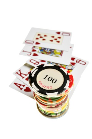 Casino chips and playing cards isolated over white background