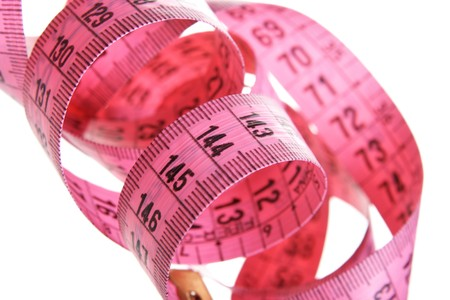 metering: Pink measuring tape isolated over white background Stock Photo