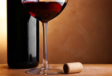 Still-life with wine bottle, cork and glass photo