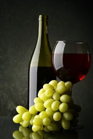 Still-life with bunch of grapes and red wine photo