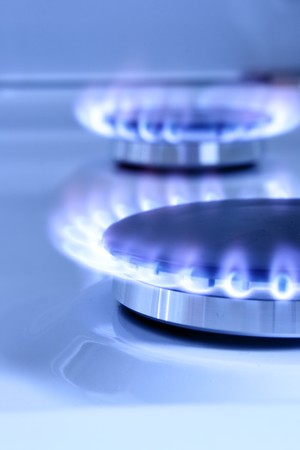 gas burner: Blue gas flame on hob and space for text on left