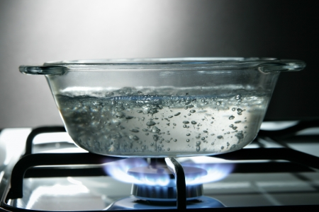 Glass saucepan on the gas stove close-up Stock Photo - 4369518