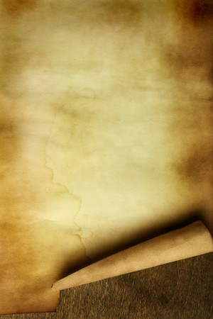 Ancient paper with curl on wooden table close up Stock Photo - 4418450