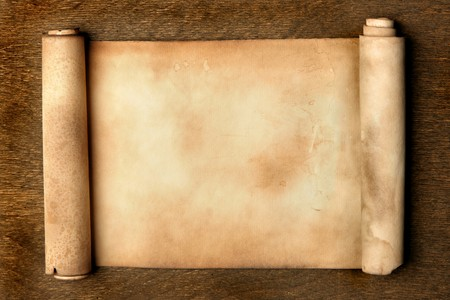 scroll paper: Ancient scroll on wooden table close up Stock Photo
