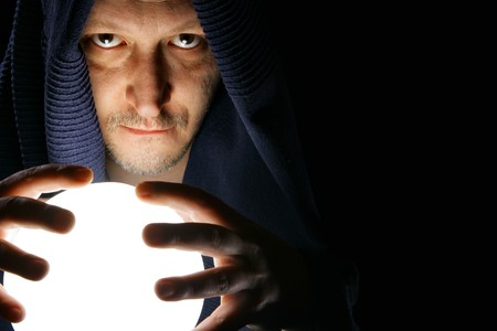 Wizard with glowing magical orb close-up photo