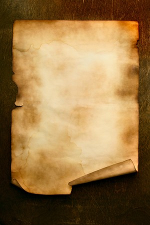 rouleau: Ancient paper with curl on wooden table close up Stock Photo