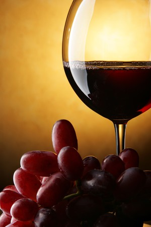 Still life with bunch of grapes and red wine photo