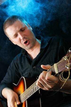 Man playing acoustic guitar at rock concert Stock Photo - 4489808
