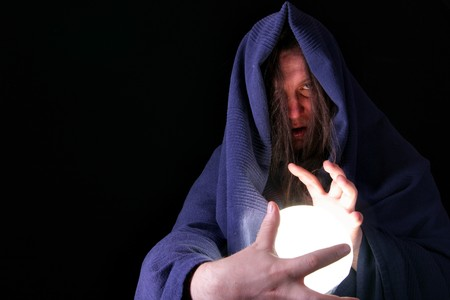 Magician with glowing magical orb close-up photo