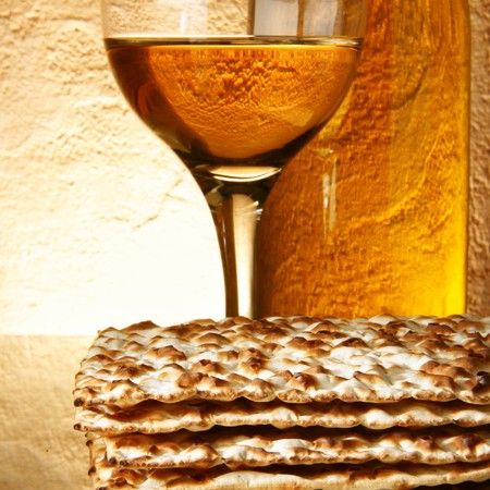 purim: Still-life with wine and matzoh (jewish passover bread)