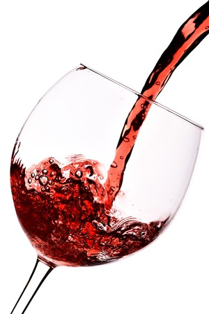 Red wine pour into glass close-up isolated over white background Stock Photo - 4558511