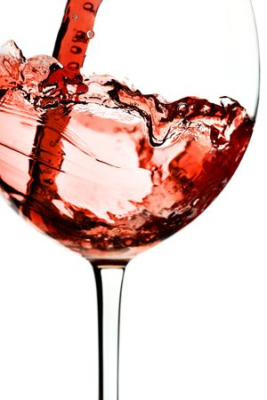 Red wine pour into glass close-up isolated over white background Stock Photo - 4617702