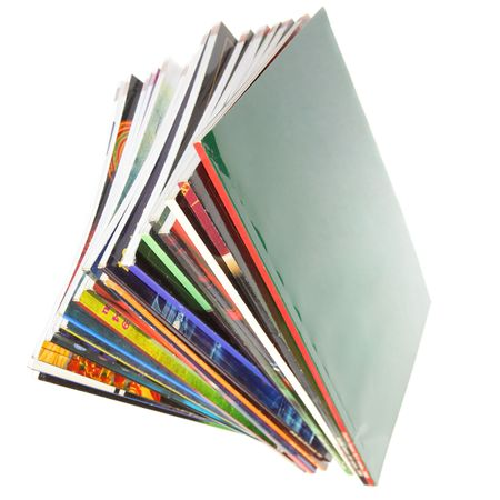 article writing: Pile of colorful magazines isolated over white background