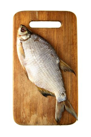 Fish on chopping board isolated over white background photo