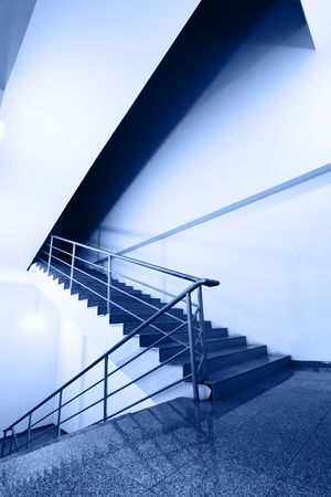 backstairs: Wide angle shot of stairs toned ib blue color
