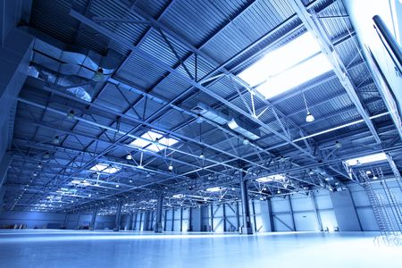 packaging industry: Empty warehouse toned in the blue color