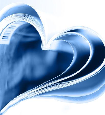 Magazine folded to heart shape over white background Stock Photo - 4745514