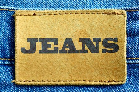 Blue jeans and leather label with word Jeans photo