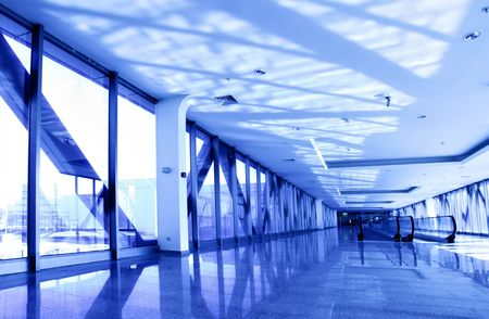 Perspective of the corridor toned in blue color photo