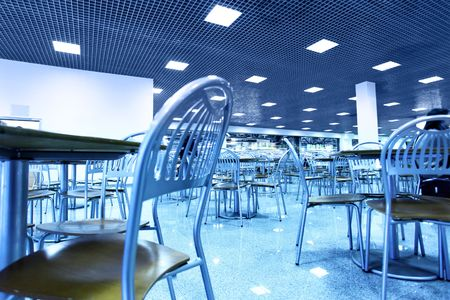 Modern interior of restaurant toned in blue color photo