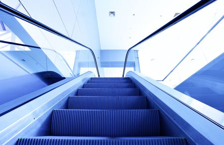 Perspective of escalator toned in blue color photo