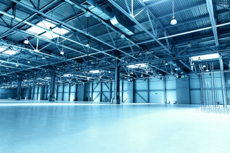 factory interior: Empty storehouse toned in the blue color Stock Photo