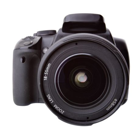 Black DSLR camera isolated over white backgrouhnd Stock Photo - 4792466