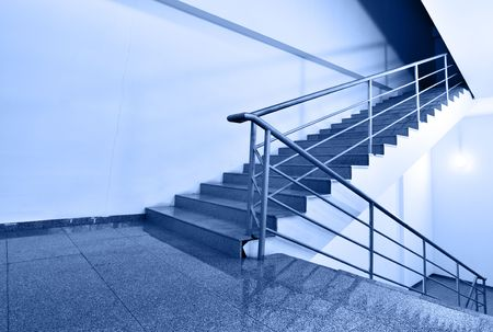 backstairs: Up or down? - Wide angle shot of stairs toned ib blue color