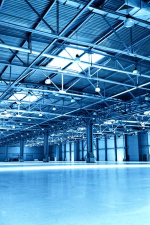 Empty storehouse toned in the blue color Stock Photo