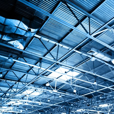 packaging industry: Ceiling of storehouse toned in the blue color Stock Photo