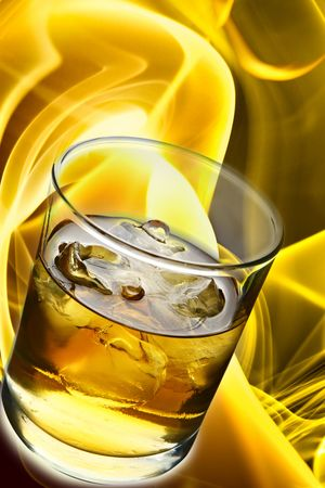 Glass of whisky with ice and fire in the background photo