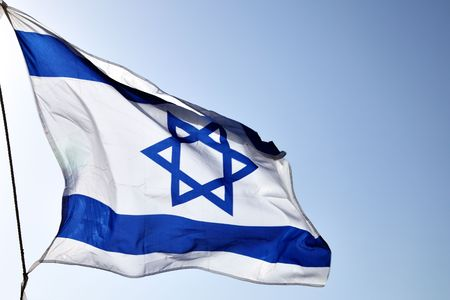 Flag of Israel on the wind close-up  photo