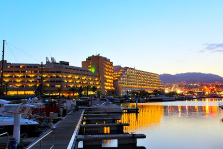 eilat: Hotels and yachts at sunset. Eilat. Israel. Stock Photo