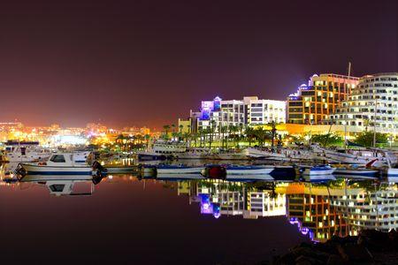 eilat: Hotels and yachts at night. Eilat. Israel.