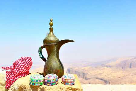 keffiyeh: Arabian souvenirs on the stone and Jordans mountains in the background