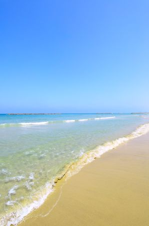 Seashore with clear water and blue sky photo