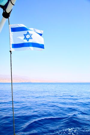 Flag of Israel on the wind, Red sea in the background Stock Photo - 4979776