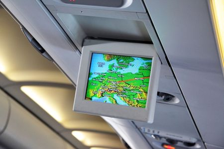 informational: Interior of airplane with informational screens (Economy class)