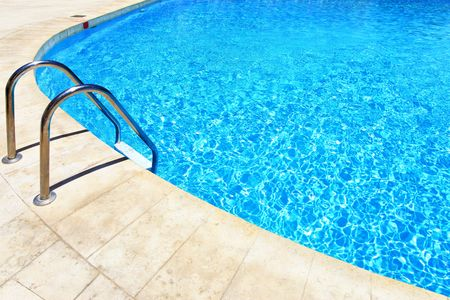 swimming in the sea: Swimming pool with stair at hotel close up