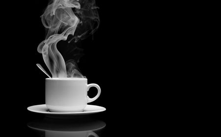 Cup of hot drink with steam over black background Stock Photo - 5112456