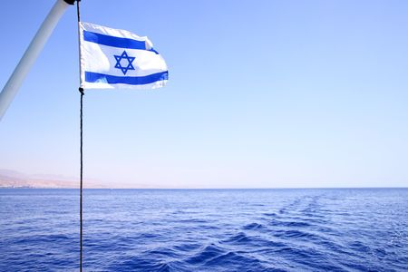 Flag of Israel on the wind, Red sea in the background Stock Photo - 5112472