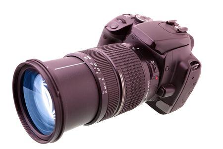 Black DSLR camera isolated over white backgrouhnd Stock Photo - 5148358
