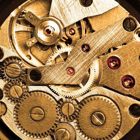 Clockwork of wristwatch macro sepia toned photo